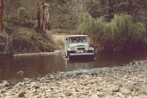 JCD driving our short wheel-base Toyota Land Cruiser across one of many river crossings, March 1973